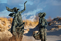 Statue of three sisters. Waiting for their husband coming from the sea Royalty Free Stock Photos