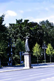 """Statue in the Tiergarten in Berlin Germany. FriedeThe statue in the foreground is called """"Der Rufer"""" The Caller or The Crier. Created by Gerhard Marcks in Stock Photography"""
