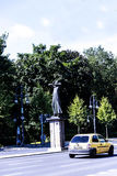 """Statue in the Tiergarten in Berlin Germany. FriedeThe statue in the foreground is called """"Der Rufer"""" The Caller or The Crier. Created by Gerhard Marcks in Royalty Free Stock Photos"""