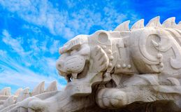 Statue of the tiger. Against blue sky Stock Photography