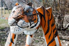 Statue of tiger from wood in detail - Painted as real tiger royalty free stock photo
