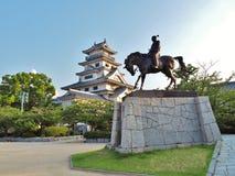 Statue of Todo Takatora and Imabari Castle. Stock Image