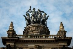 Statue on top of Opera in Dresden royalty free stock photo