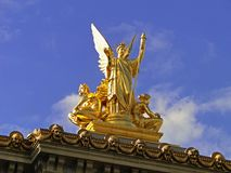 Statue in the top of Opera Garnier, Paris. The exterior of the Palais Garnier Opera House offers a dazzling and opulent neo-baroque architecture with several stock photography