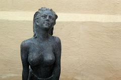 Statue of topless chest woman in english garden. Royalty Free Stock Photos