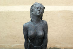 Statue of topless chest woman in english garden. Stock Photos