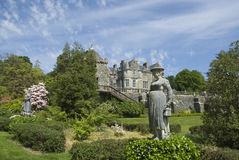 Statue, Torosay Gardens. Statue on a sunny, summers day at Torosay gardens, Isle of Mull, Scotland, with Torosay house behind Royalty Free Stock Image