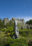 Statue, Torosay Gardens. Portrait view of statue on a sunny, summers day at Torosay gardens, Isle of Mull, Scotland, with Torosay house behind Stock Image