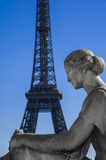 Statue with Tour Eiffel Stock Image