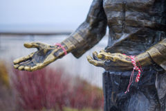 Statue with traditional bracelets Royalty Free Stock Photo