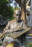 Statue of traditional chinese gentleman working on chinese abacus, modern art city sculpture in China Stock Photography