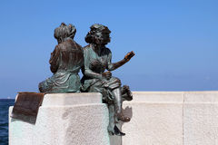 Statue in Trieste, Italy. Bronze statue of two ladies on the seafront promenade in Trieste, Italy Stock Photos