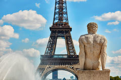 Statue on the Trocadero view pont in front of the Eiffel tower. Male statue on the Trocadero view pont in front of the Eiffel tower Stock Photo