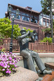 Statue of trumpet player in front of Weathercock House in historic area of Kitano district in Kobe, Japan Stock Photo