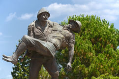 Statue Of A Turkish Soldier Carrying Australian Soldier, Canakkale, Turkey. Canakkale , Turkey - July 17, 2014: Statue representing a Turkish soldier from royalty free stock images