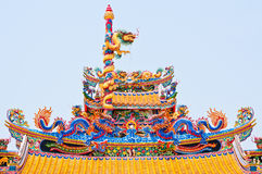 Statue of twin dragons. On the roof of Chinese temple Stock Photos