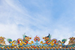 Statue of twin dragons on the chinese temple roof Stock Image