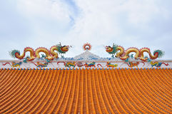 Statue of twin dragons on the roof. Of Chinese temple Royalty Free Stock Image