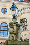 Statue of two angels with lamp Stock Image