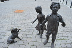Statue of two children and a dog Royalty Free Stock Photo