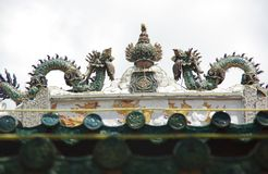 Statue of two dragons battling for ovum on the roof of a temple. In the South of Vietnam, Mekong Delta, South East Asia Stock Photography