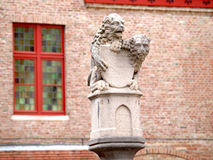 Statue of two lions guarding the shield, Bruges Stock Photo