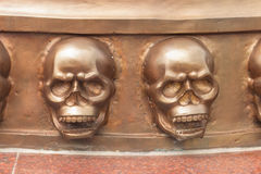 Statue of two skulls on the walls. Statue skull sculpture from the metal Stock Image