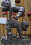 Statue of two small chinese gymnasts Stock Image