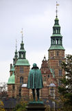 Statue of Tycho Brahe looking towards the renaissance castle Rosenborg in Copenhagen. The castle was build 23 years after Tycho's Royalty Free Stock Images