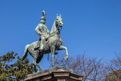Statue in Ueno park ,Tokyo ,Japan. TOKYO ,JAPAN - FEBRUARY 2,2016 : Statue of Prince Komatsu-no-miya Akihito in Ueno Park. He was an Imperial prince who royalty free stock image