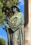 Statue of Ulrich Zwingli in Zurich. Upper part of the statue of Ulrich Zwingli at the Water Church (German: Wasserkirche) in Zurich, Switzerland. The bronze Royalty Free Stock Photos