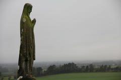Statue und Landschaft Stockbild