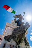 Statue under the Italian flag Royalty Free Stock Photos