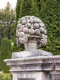 Statue a vase with fruit in the garden of the Peles castle in Sinaia, in Romania Royalty Free Stock Images