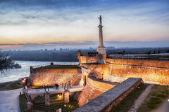 Statue of Victory with a monument in Belgrade, Serbia Royalty Free Stock Image