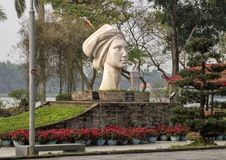 The statue of a Vietnamese girl, sculpted by Le Thanh Nhon, located in Hue along the Parfume River. Pictured is a `The statue of a Vietnamese Girl`, sculpted royalty free stock photography