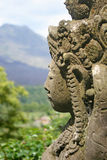 Statue and view of Batur volcano from restaurant Stock Image