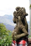 Statue and view of Batur volcano from restaurant Royalty Free Stock Photography