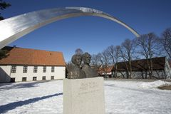 Statue beside viking ship museum stock image