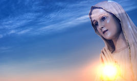 Statue of the Virgin Mary against sunrise Royalty Free Stock Photo