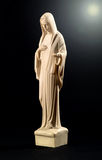 Statue of the Virgin Mary on black Royalty Free Stock Image