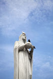 A statue of the Virgin Mary in the blue sky Royalty Free Stock Photography