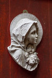 Statue Virgin Mary carrying. The baby at the door Royalty Free Stock Photography