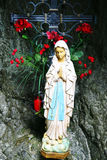 Statue of the Virgin Mary in a cave. Praying graceful for safety Stock Photography