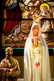 Statue of Virgin Mary. In the church royalty free stock images