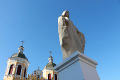 Statue of the Virgin Mary and Church. Statue of the Virgin Mary and the Church against the blue sky Royalty Free Stock Image