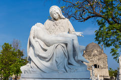 Statue of the Virgin Mary cradling a dead Jesus. Beautiful emotional  statue of the young Virgin Mary cradling the dead body of Jesus Stock Image
