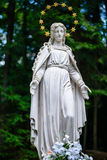 Statue of Virgin Mary. In crown of 12 stars Stock Image