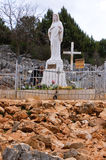 The statue of Virgin Mary in front of the church of Saint James Royalty Free Stock Photo