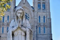 Statue of the Virgin Mary Fronting the Basilica in Guelph. The Virgin Mary`s statue stands in the foreground to the Basilica of Our Lady Immaculate in Guelph Stock Photography